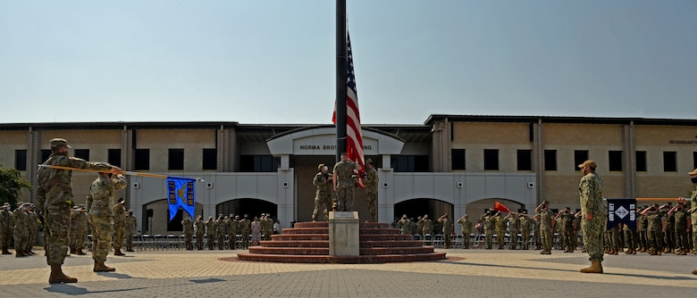 Joint Service Color Guard members lower the U.S. flag during the Retreat Ceremony outside of the Norma Brown building on Goodfellow Air Force Base, Texas, Sept. 10, 2021 The event paid tribute to commemorate the 20th anniversary of those lost during the attacks on 9/11. (U.S. Air Force photo by Senior Airman Abbey Rieves)