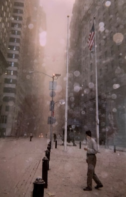 People walk in a dust and debris-filled street after the collapse of the first Twin Tower and look towards the fire coming from the second on Sept. 11, 2001, in front of the World Trade Center, New York City, New York. Col. Ephod Shang, vice commander of the 367th Recruiting Group and deputy director at the AFRC Headquarters for Recruiting on Robins AFB, Georgia, and others were hiding behind a random structure when the first tower fell, the dust completely blocked their vision.