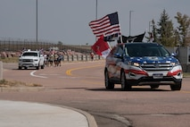 Police escort runners during event honoring fallen service members
