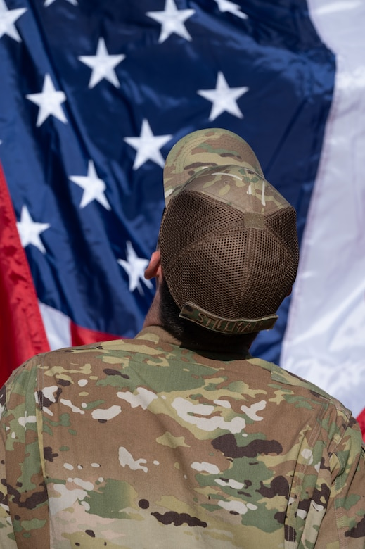 Airman looking up at the American flag