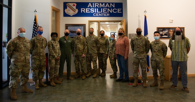 Airman Resilience Center (ARC) personnel and 354th fighter wing leadership pose for a group photo during a ribbon cutting ceremony on Eielson Air Force Base, Alaska, Sept. 9, 2021.