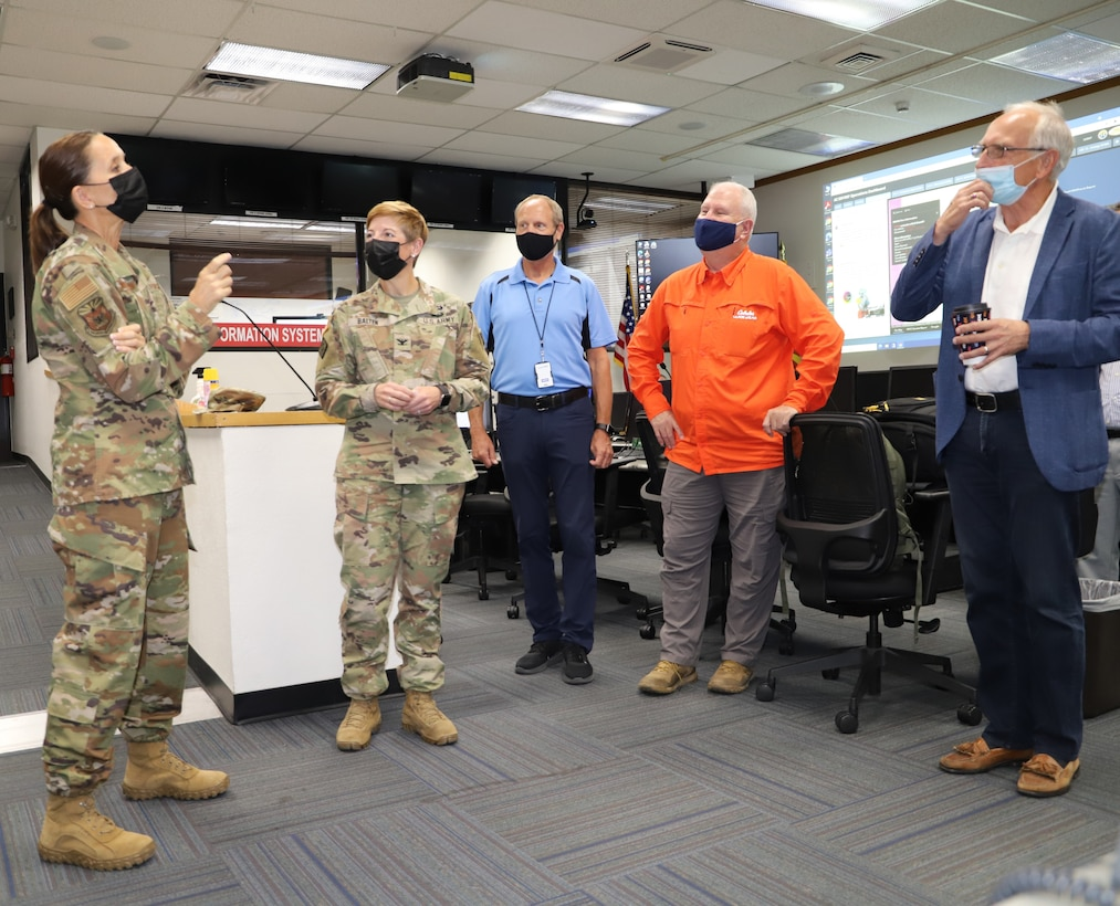 Adjutant General of the Arizona National Guard Maj. Gen. Kerry Muehlenbeck, center, discusses the importance of emergency response preparedness during a joint flood response exercise at the Arizona Emergency Operations Center Sept. 9 in Phoenix. The U.S. Army Corps of Engineers Los Angeles District, the Arizona Department of Emergency and Military Affairs, and the Flood Control District of Maricopa County staff conducted a joint exercise to evaluate flood response preparedness. The training featured various flooding scenarios at the Painted Rock Dam located 120 miles southwest of Phoenix.