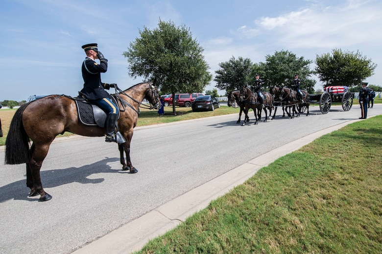 Soldiers with the Fort Sam Houston Caisson Section carry the flag-draped remains of Col. Richard E. Cole during his interment ceremony, Sept. 7, 2021 at the Fort Sam Houston National Cemetery.