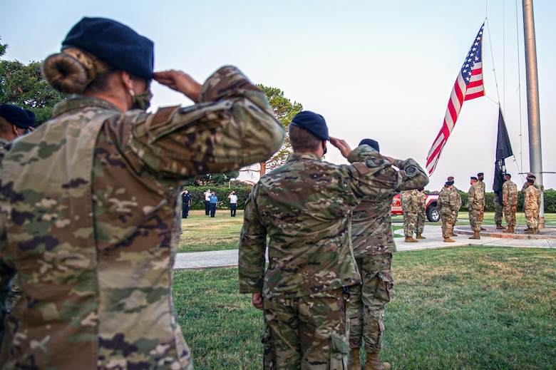 Members of the 502nd Air Base Wing salute as the U.S. flag is lowered to half-staff at Joint Base San Antonio-Fort Sam Houston Sept. 10 in honor of those lost in the terrorist attacks of Sept. 11, 2001.