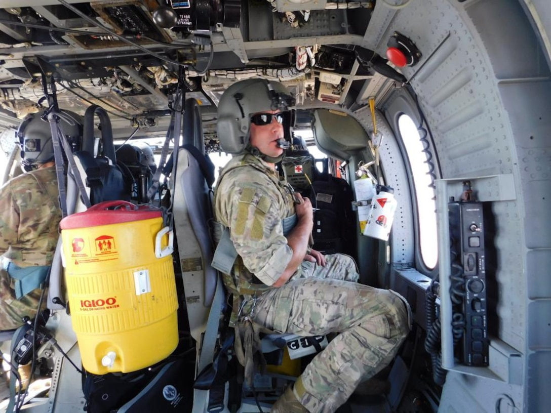 Air Force aircrew member aboard HH-60G Pave Hawk helicopter.