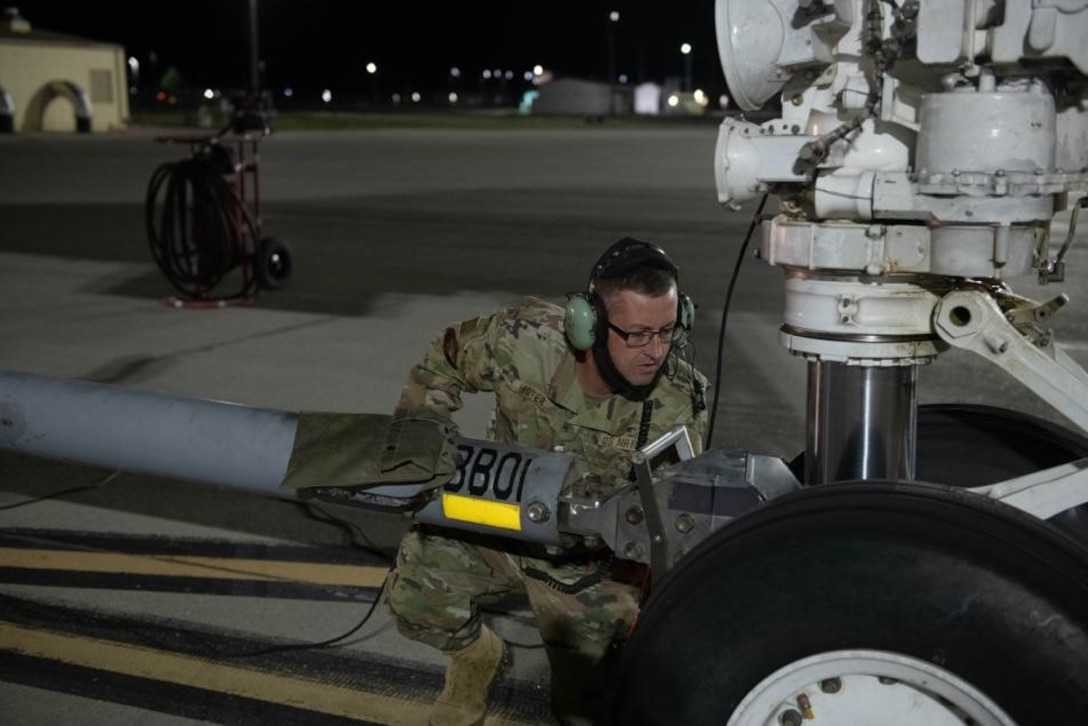U.S. Air Force Tech. Sgt. Nathan Moyer, 28th Aircraft Maintenance Squadron crew chief, hooks up a tow bar to a B-1B Lancer in support of a Bomber Task Force mission at Ellsworth Air Force Base, S.D., Sept. 8, 2021.