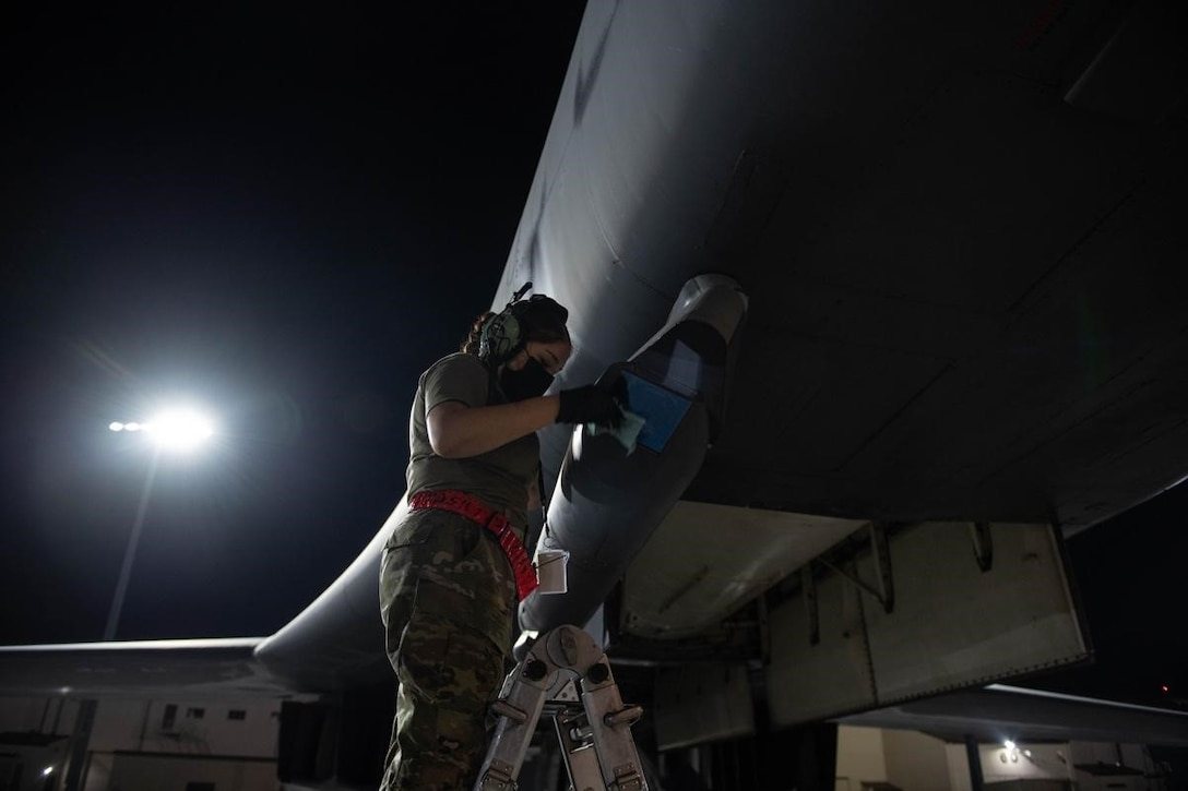 A crew chief from the 28th Aircraft Maintenance Squadron inspects and cleans a sniper advanced targeting pod on a B-1B Lancer in preparation for a Bomber Task Force mission at Ellsworth Air Force Base, S.D., Sept. 7, 2021.
