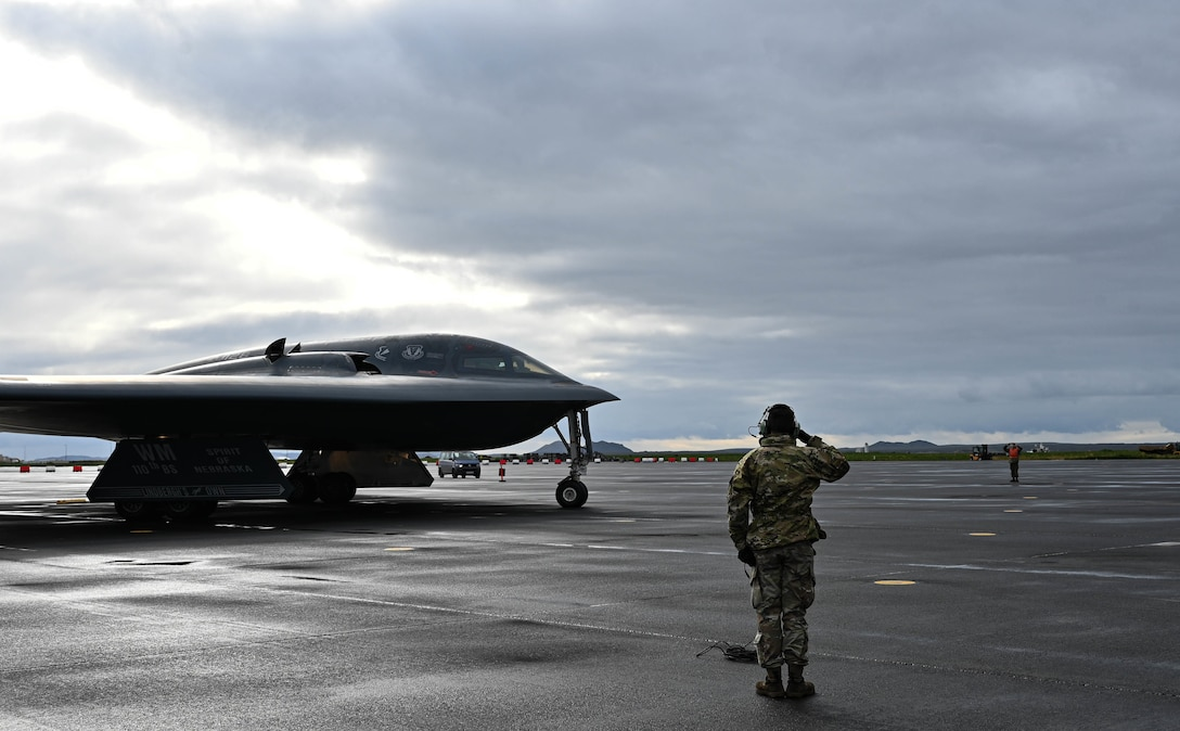 Staff Sgt. Ian Simms, 110th Expeditionary Bomb Squadron dedicated crew chief, prepares a B-2 Spirit stealth bomber for departure from Keflavik Air Base, Iceland, Sept. 8, 2021. The stealth bombers integrated with Royal Norwegian Air Force F-35A Lightning II enhancing bomber interoperability with partners and allied nations. (U.S. Air Force photo by Airman 1st Class Victoria Hommel)
