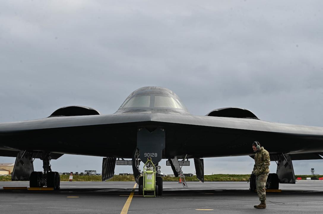Staff Sgt. Ian Simms, 110th Expeditionary Bomb Squadron dedicated crew chief, prepares a B-2 Spirit stealth bomber for departure from Keflavik Air Base, Iceland, Sept. 8, 2021. The stealth bombers integrated with Royal Norwegian Air Force F-35A Lightning II aircraft enhancing bomber interoperability with partners and allied nations. (U.S. Air Force photo by Airman 1st Class Victoria Hommel)