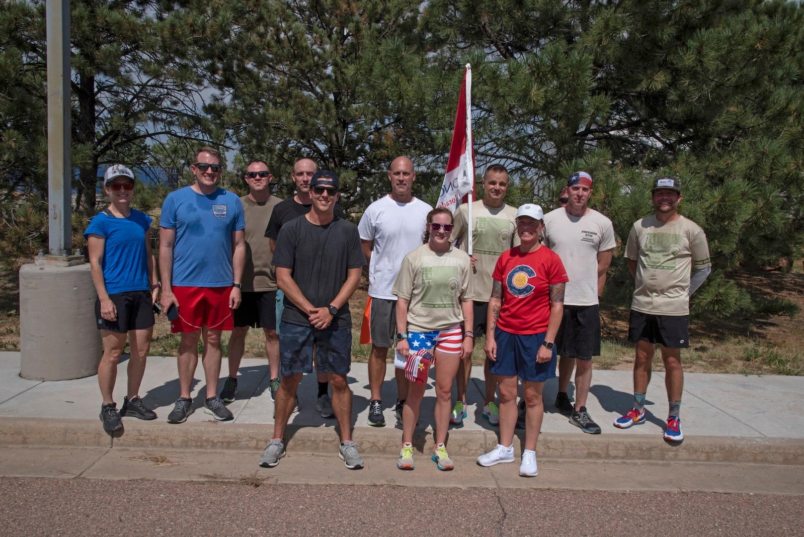 Runners pose for photo following fallen service member run