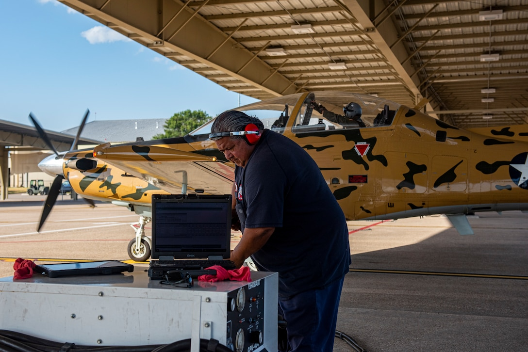 Ruben Balderas, 47th Flying Maintenance Directorate aircraft attendant, participates in the preparations of a Texan II T-6 take off at Laughlin Air Force Base, on Sept. 8 2021. National Hispanic Heritage Month is a period from September 15 to October 15 in the United States for recognizing the contributions and influence of Hispanic Americans to the history, culture, and achievements of the United States.