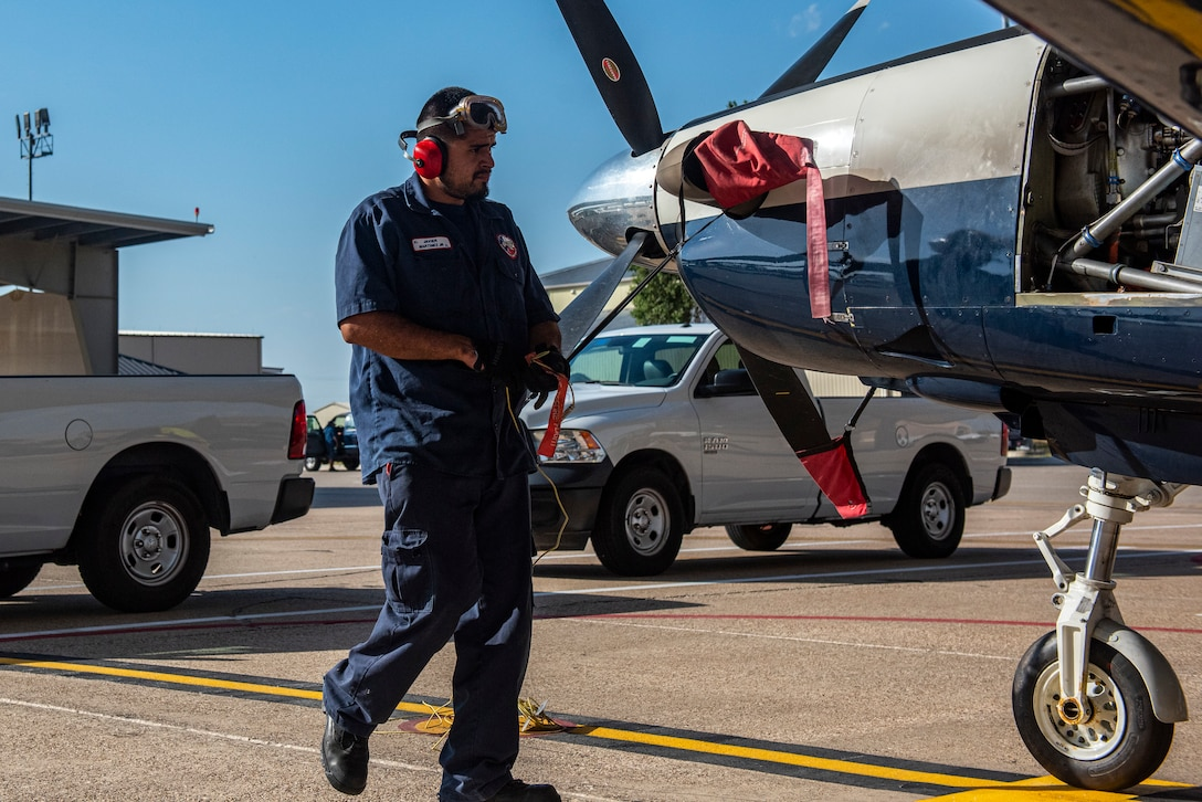 Javier Martinez, 47th Flying Maintenance Directorate aircraft attendant, prepares a Texan II T-6 before its voyage at Laughlin Air Force Base, Texas on Sept. 8 2021. National Hispanic Heritage Month is a period from September 15 to October 15 in the United States for recognizing the contributions and influence of Hispanic Americans to the history, culture, and achievements of the United States.