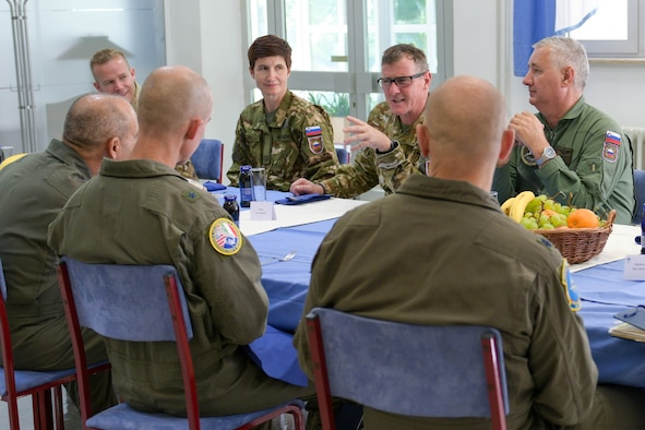 BG Roman Urbanč, deputy chief of the general staff of the Slovenian armed forces, speaks with U.S. Air Force Brig. Gen. Jason E. Bailey, 31st Fighter Wing commander, middle, and U.S. Air Force Gen. Jeff Harrigian, U.S. Air Forces in Europe and Air Forces Africa commander, left, at Cerklje ob Krki Air Base, Slovenia, Sept. 9, 2021. The visit highlighted bilateral operations and interoperability between U.S. and Slovenian Armed Forces in support of the NATO Agile Combat Employment concept. The ACE concept is intended to ensure USAFE-AFAFRICA forces are ready for potential threats and contingencies by enabling forces to quickly disperse and continue to deliver air power from locations with varying levels of capacity and support.
