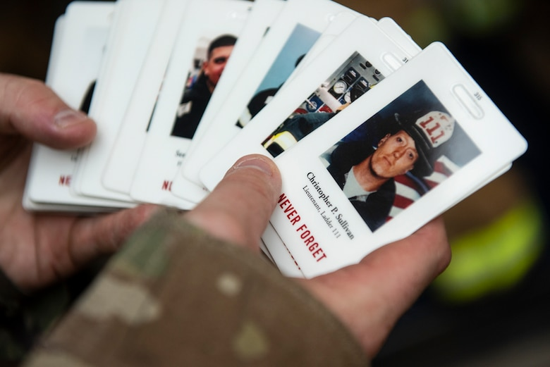 Participants carried one of these cards during each of their stair climbs to honor a first responder during a 20th Anniversary 9/11 Remembrance Ceremony at Osan Air Base, Republic of Korea, Sept. 11, 2021.