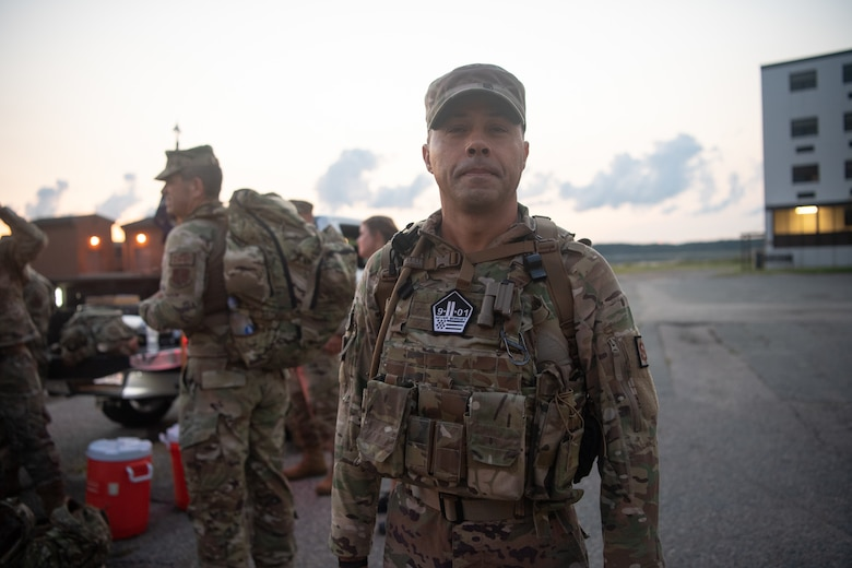 An Airman stands outside in the early morning