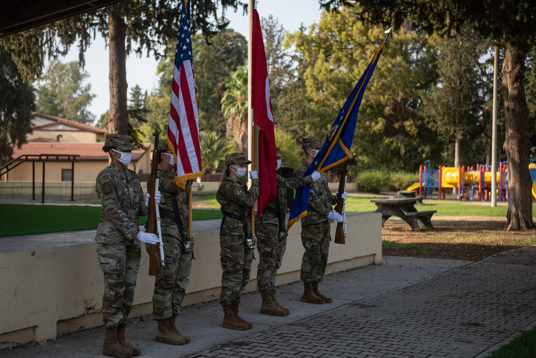 Honor guardsmen presenting flags at ceremony