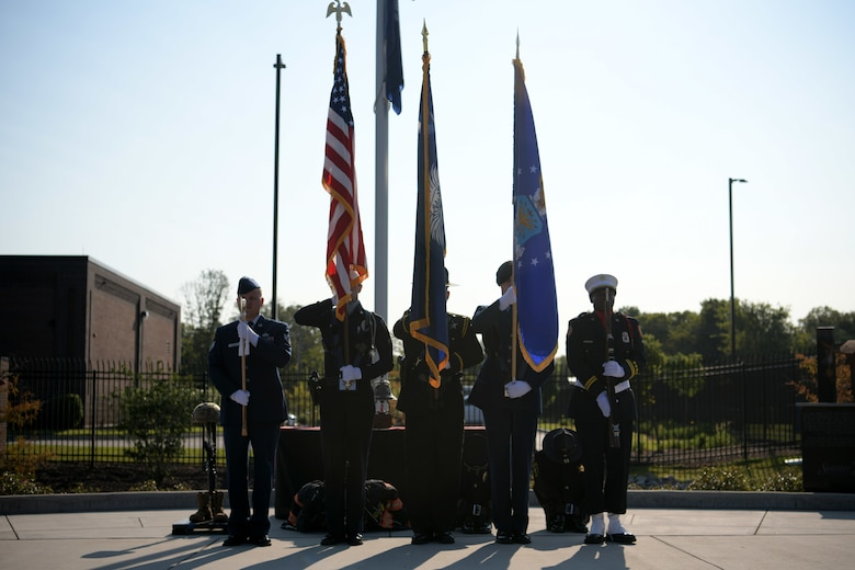 Members of a joint Shaw Air Force Base and Sumter honor guard present the colors as the national anthem is sung during a 9/11 memorial ceremony in Sumter, S.C., Sept. 11, 2021. The ceremony was held in remembrance of the 20th anniversary of the Sept. 11, 2001, attacks across the United States. (U.S. Air Force photo by Staff Sgt. K. Tucker Owen)
