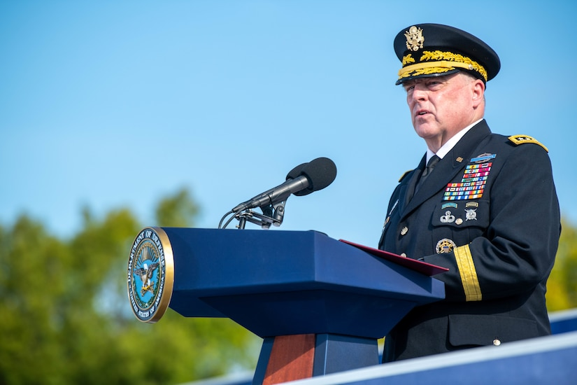 An Army general in uniform speaks at a podium.