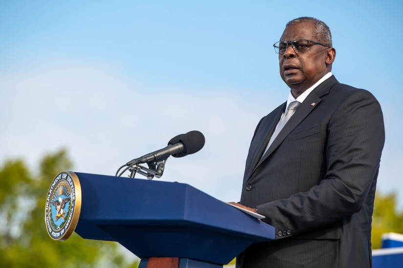 The Secretary of Defense speaks at a podium.