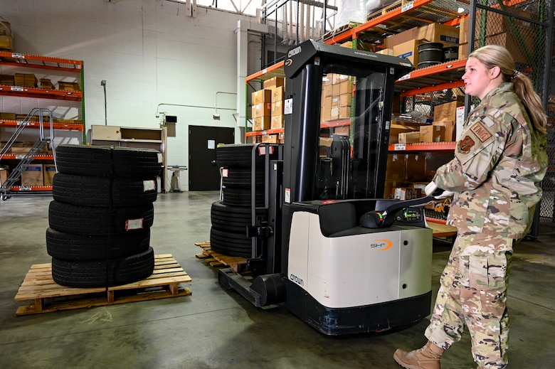 Senior Airman Sadie Vandersteen, 114th Logistics Readiness Squadron Traffic Management Office (TMO) specialist, operates a heavy duty Walkie Stacker while organizing shipments in the TMO warehouse.