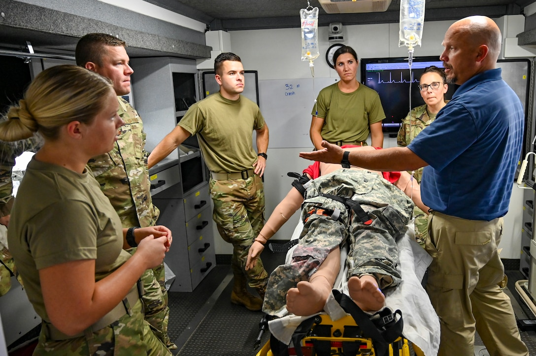 114th Medical Group medics receive scenario based training from a local health care professional utilizing a high fidelity patient simulator mannequin during the 114th Fighter Wing 2021 Readiness Exercise.