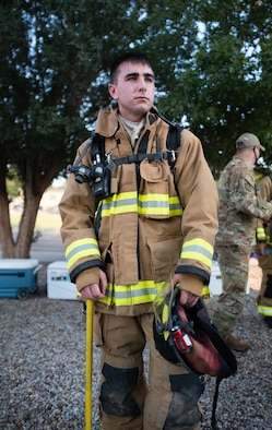 Senior Airman Eli Kirwan, 27th Special Operations Civil Engineering Squadron firefighter, watches the remaining participants exit the Air Traffic Control tower after a 9/11 memorial climb at Cannon Air Force Base, N.M., Sep. 11, 2021. Each participant ascended and descended nine flights of stairs multiple times, while wearing full emergency and tactical gear and carrying the names of emergency first responders who lost their lives responding to the terrorist attacks on the United States 20 years ago. (U.S. Air Force photo by Senior Airman Christopher Storer)