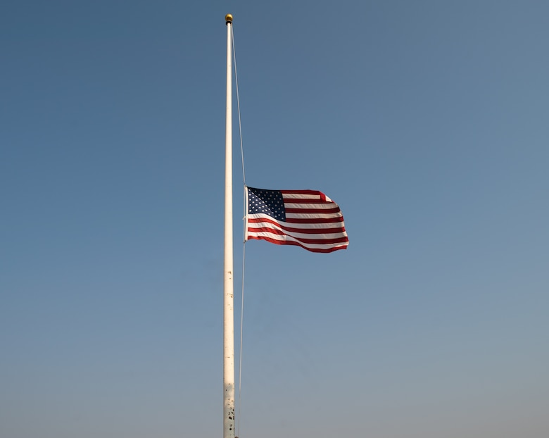 An American flag flutters at half mast at Cannon Air Force Base, N.M., Sep. 11, 2021. The flag is flown at half mast every September 11 in memoriam of the terrorist attacks on the United States at the World Trade Center in New York City, N.Y., Shanksville, P.A., and the Pentagon in Washington D.C. (U.S. Air Force photo by Senior Airman Christopher Storer)