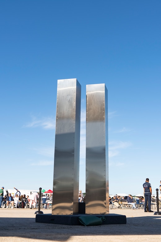A replica of the twin towers is unveiled at a memorial ceremony at Pease Air National Guard Base, New Hampshire, Sept. 11, 2021. The replica was designed and built entirely by Airmen assigned to the 157th Air Refueling Wing. (U.S. Air National Guard photo by Staff Sgt. Taylor Queen)