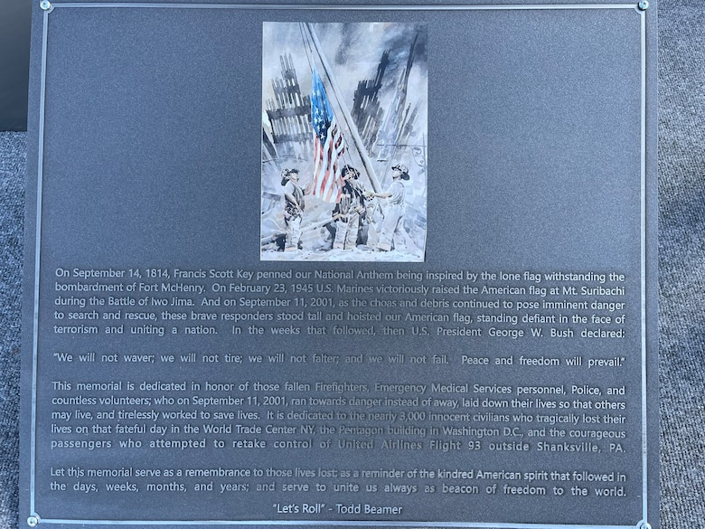A memorial plaque fresh from laser etching is prepared to be placed at the bottom of the twin towers replica at Pease Air National Guard Base, New Hampshire, Sept. 10, 2021. The replica and plaque was designed and built by Pease Airmen. (Courtesy photo)