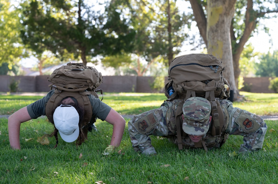 Team Kirtland Airmen perform push-ups for the 20th anniversary of 9/11.