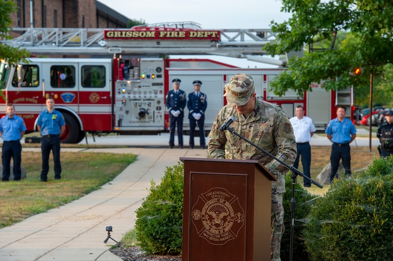 Capt. Blake Campbell, 434th Air Refueling Wing chaplain, speaks during a 9/11 remembrance ceremony at Grissom Air Reserve Base, Indiana, Sept. 11, 2021.  Campbell spoke on the events that transpired 20 years ago and delivered a prayer for those who lost their lives as well as the families affected that day. (U.S. Air Force photo by Staff Sgt. Michael Hunsaker)