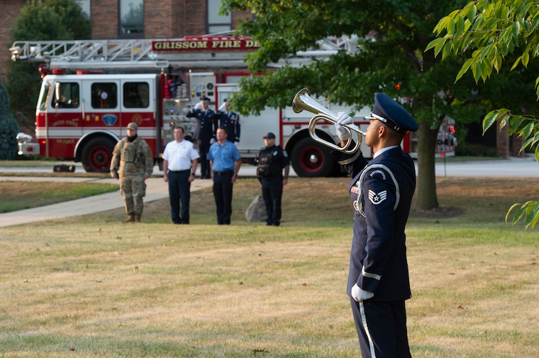 Staff Sgt. Jeffrey Merza, 434th Civil Engineering Squadron engineering assistant apprentice, plays a bugle during a 9/11 remembrance ceremony at Grissom Air Reserve Base, Indiana, Sept. 11, 2021.  Merza played taps to honor those who lost their lives during the attack 20 years ago. (U.S. Air Force photo by Staff Sgt. Michael Hunsaker)