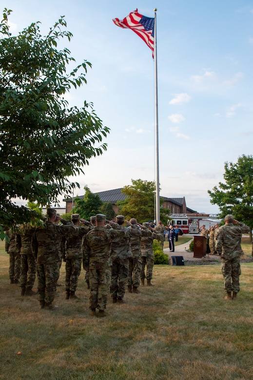 Grissom Airmen from Grissom Air Reserve Base salute during a 9/11 remembrance ceremony at Grissom Air Reserve Base, Indiana, Sept. 11, 2021.  The ceremony marked the 20th anniversary of the attack that took the lives of almost 3000 Americans. (U.S. Air Force photo by Staff Sgt. Michael Hunsaker)