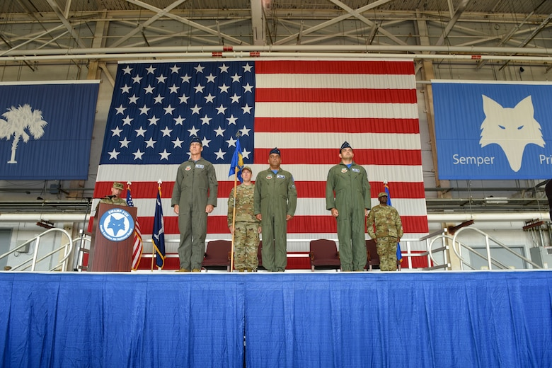 The South Carolina Air National Guard's 169th Fighter Wing conducts a change of command ceremony at McEntire Joint National Guard Base, South Carolina, Sept. 11, 2021, where U.S. Air Force Col. Quaid Quadri Jr., right, assumes command from Col. Akshai Gandhi., center. Brig. Gen. Boris Armstrong, Chief of Staff, South Carolina Air National Guard, left, presides over the ceremony. (U.S. Air National Guard photo by Tech Sgt. Megan Floyd, 169th Fighter Wing Public Affairs)