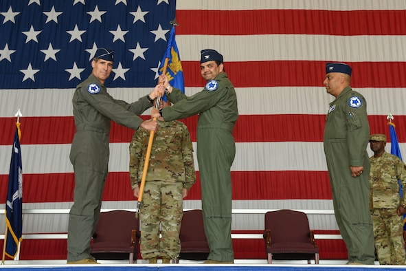 The South Carolina Air National Guard's 169th Fighter Wing conducts a change of command ceremony at McEntire Joint National Guard Base, South Carolina, Sept. 11, 2021, where U.S. Air Force Col. Quaid Quadri Jr., center, assumes command from Col. Akshai Gandhi., right. Brig. Gen. Boris Armstrong, Chief of Staff, South Carolina Air National Guard, left, presides over the ceremony. (U.S. Air National Guard photo by Tech Sgt. Megan Floyd, 169th Fighter Wing Public Affairs)