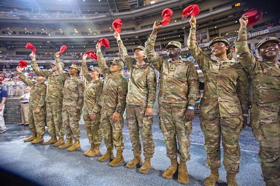U.S. Air Force Maj. Gen. Sherrie McCandless, commanding general, District of Columbia National Guard, joins members of the D.C. Army and Air National Guard in raising their hats during the Washington Nationals' Salute to Service at Nationals Park in Washington, D.C., Aug. 13, 2021. The Nationals dedicate a special game each season to honor and celebrate each branch of the military and McCandless, who is also a veteran fighter pilot, was selected to represent servicemembers during National Guard Day at the stadium. (U.S. Air Force photo by Master Sgt. Amber Monio)
