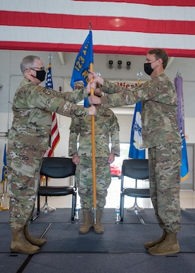Col. Ryan Adams (right), incoming commander of the 123rd Contingency Response Group, accepts the unit's guidon from Col. David Mounkes (left), outgoing commander of the 123rd Airlift Wing, during a change-of-command ceremony at the Kentucky Air National Guard Base in Louisville, Ky., Aug 7, 2021. Adams is replacing Col. Bruce Bancroft, who assumed command of the 123rd Airlift Wing during a ceremony later the same day. (U.S. Air National Guard photo by Phil Speck)