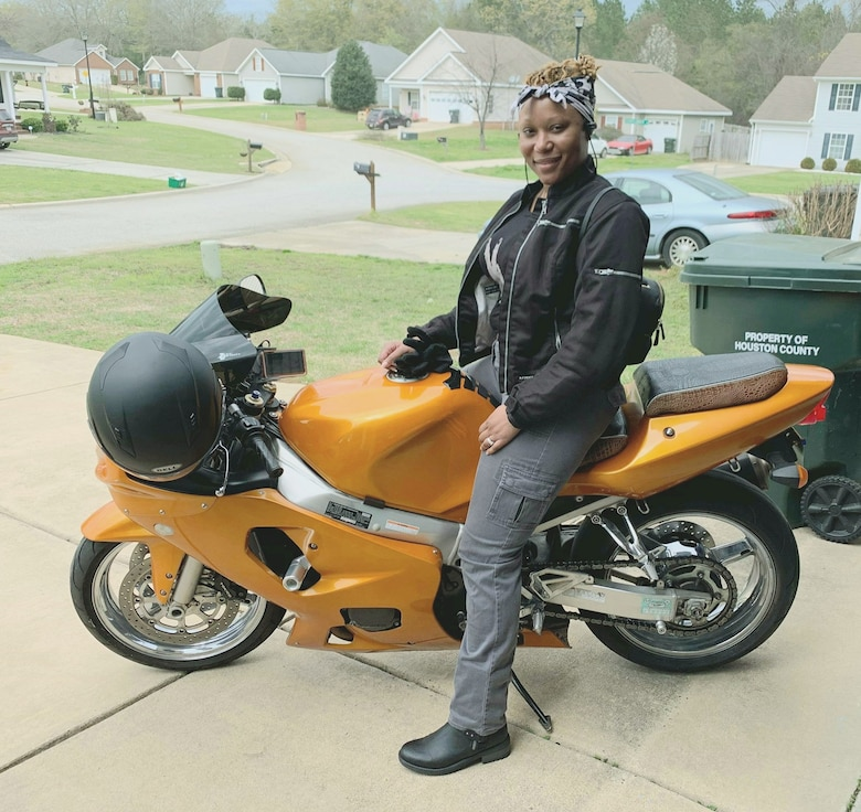 Picture of Chief Master Sgt. Lorna Major with her motorcycle.  Majors joined the 931st Air Refueling Wing as command chief during the September Unit Training Assembly.
