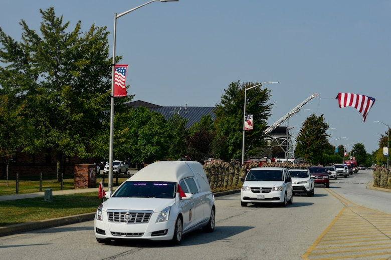 Members of the Hoosier Wing line the road and render a salute as the hearse transporting the remains of U.S. Marine Corps Cpl. Humberto A. Sanchez of Logansport, Indiana, passes by Sept. 12, 2021 at Grissom Air Reserve Base, Indiana. Sanchez was one of 13 U.S. service members killed Aug. 26, 2021, as the result of an enemy attack while supporting evacuation efforts for Operation Freedom's Sentinel in Kabul, Afghanistan. (U.S. Air Force photo by Staff Sgt. Jeremy Blocker)