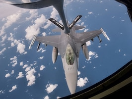 A KC-135 Stratotanker with the 927th Air Refueling Wing, Florida, refuels an F-16 Fighting Falcon with the 482nd Fighter Wing, Florida, on September 11, 2021.  On the Stratotanker were 927th ARW quarterly and annual award winners who earned the opportunity to watch a refueling, the Wing's primary mission.  (U.S. Air Force photo by Staff Sgt. Tiffany A. Emery)