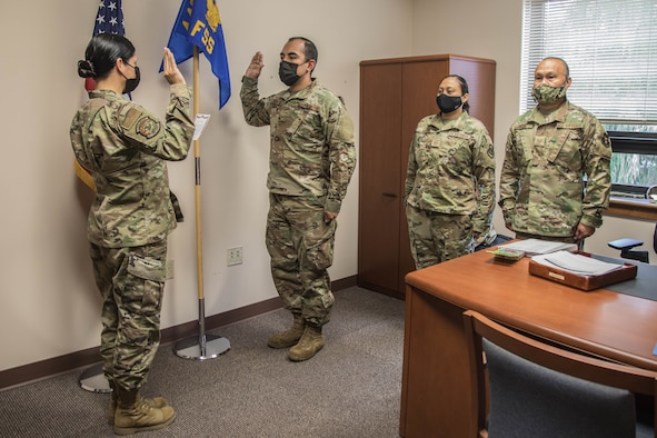 Airman raised his right hand to take the oath of enlistment.
