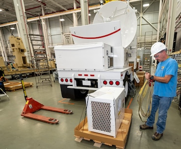 Photo of  Chris Katchmar installing an environmental control unit