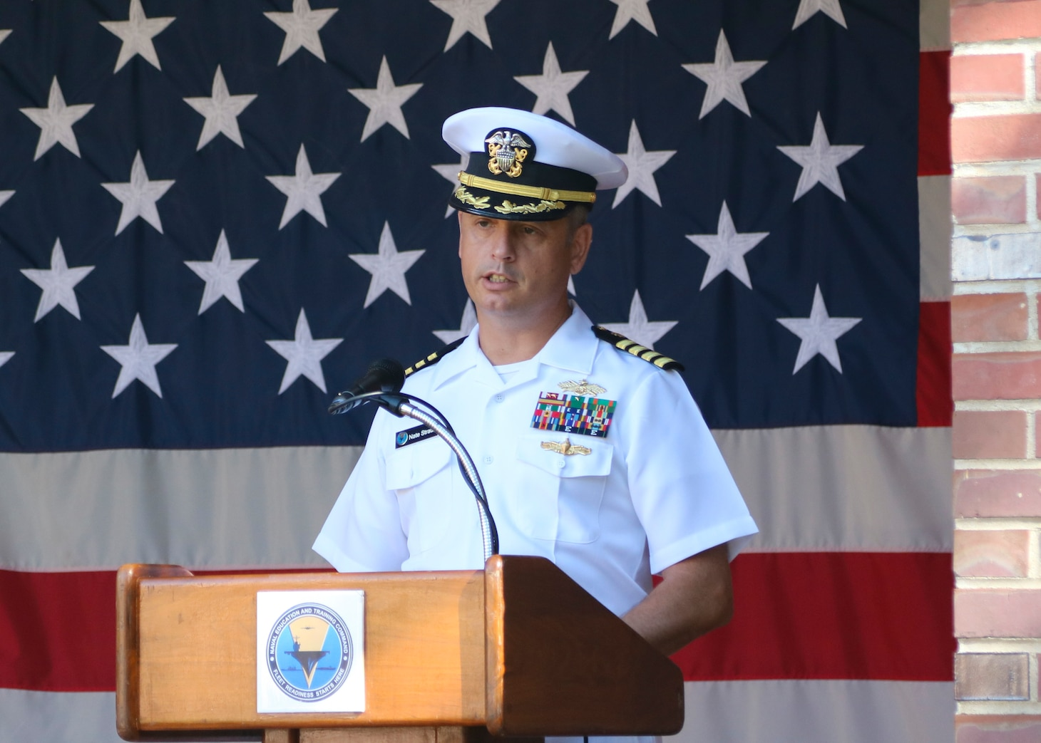 Capt. Nate Straub, director of facilities and logistics, at Naval Education and Training Command (NETC), speaks during a 9/11 memorial ceremony.