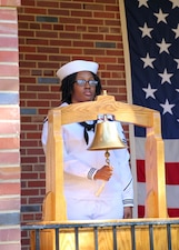 Yeoman 1st Class Shaqwala R. Vega rings a bell in memory of those who died on 9/11 during a memorial ceremony.
