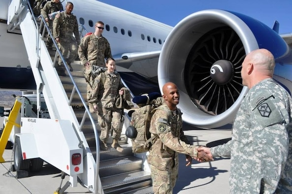 U.S. Army Command Sgt. Maj. Aarion Franklin, Maryland National Guard, is greeted after returning from deployment to Afghanistan Jan. 28, 2014, at Fort Bliss, El Paso, Texas. Franklin was among the many MDNG members who responded to the attacks on Sep. 11, 2001.