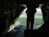 U.S. Marine Staff Sgt. Brian D Mays, a crew chief with VMM-261, assists in the air lift of Marines to support Task Force 51 in Ft. Polk in support of Defense Support for Civil Authorities (DSCA) operations with FEMA. NAS Chambers Field, Norfolk Va. (Released/U.S. Marine Corps photo by 1st Lt. Aaron Ladd)