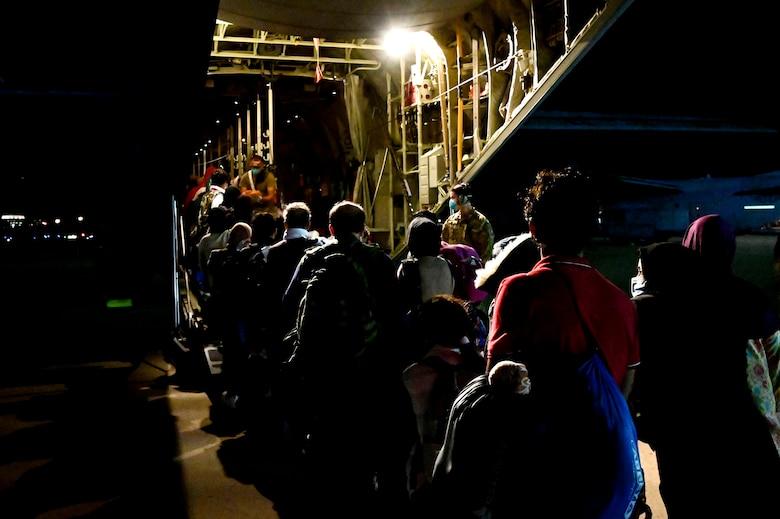 Afghan evacuees board a C-130J