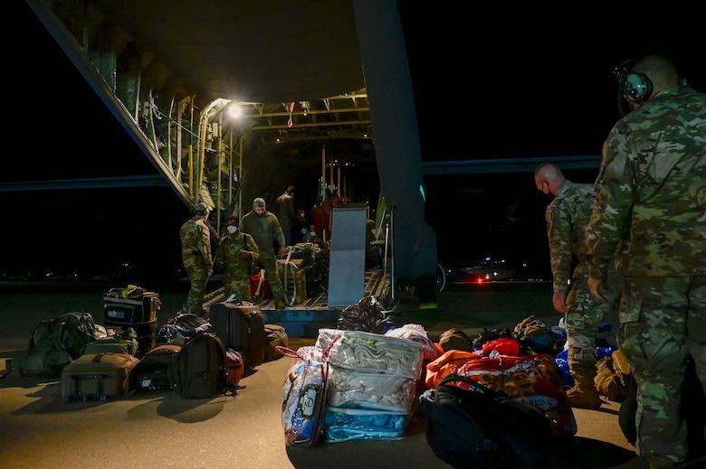 Airmen load cargo onto a C-130J