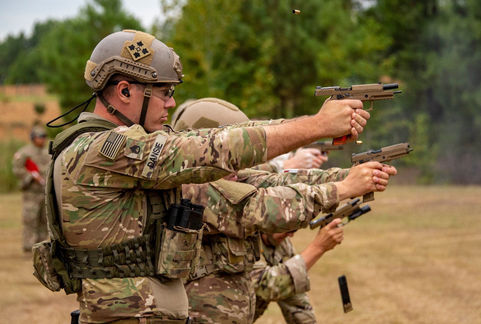 Staff Sgt. James Dansie, Utah National Guard, fires his pistol Sept. 2, 2021, during the General George Patton Combat Pistol match of the 50th Winston P. Wilson and the 30th Armed Forces Skill at Arms Championships, hosted by the National Guard Marksmanship Training Center, held at the Robinson Joint Maneuver Training Center, North Little Rock, Ark.