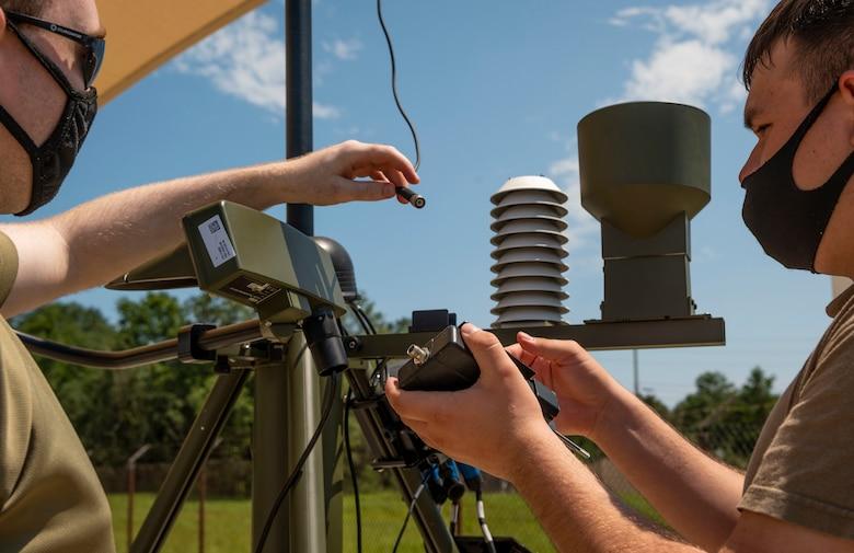 Airmen fix a tactical meteorological observing system